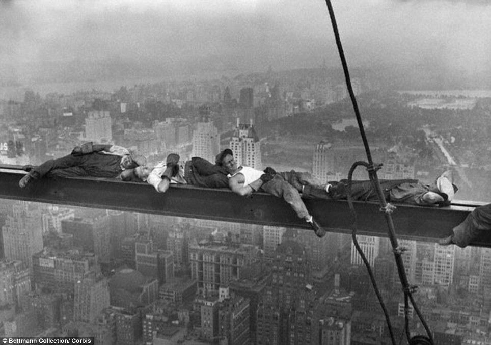 Men Asleep on a Girder. Construction workers sleeping midair on a crossbeam over New York City. Photographer: Charles C. Ebbets.