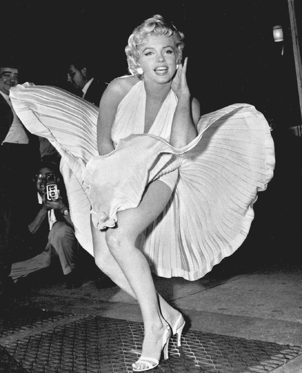 Marilyn Monroe posing as her dress billowed up. Photographer Matty Zimmerman.