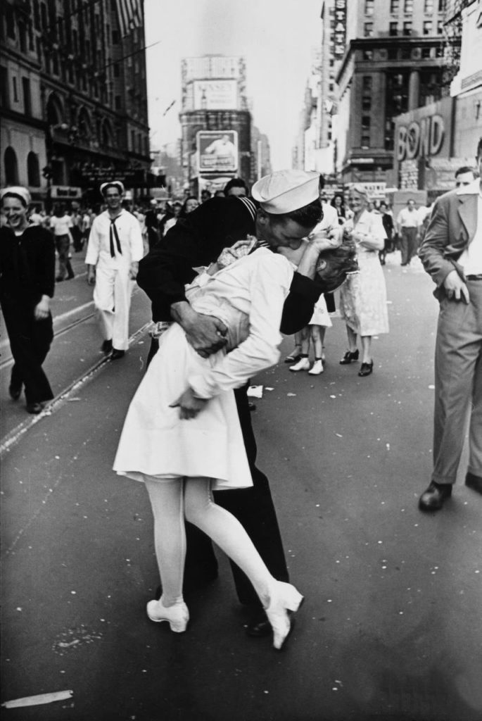 A sailor kissing a lady. V-J Day in Times Square. Photograph by Alfred Eisenstaedt.