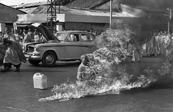 The Burning Monk. Self-immolation act of Thích Quảng Đức. The Vietnamese monk remained perfectly still while he burned to death. Photograph by Malcolm Browne. A similar photograph by Browne won World Press Photo of the Year award.