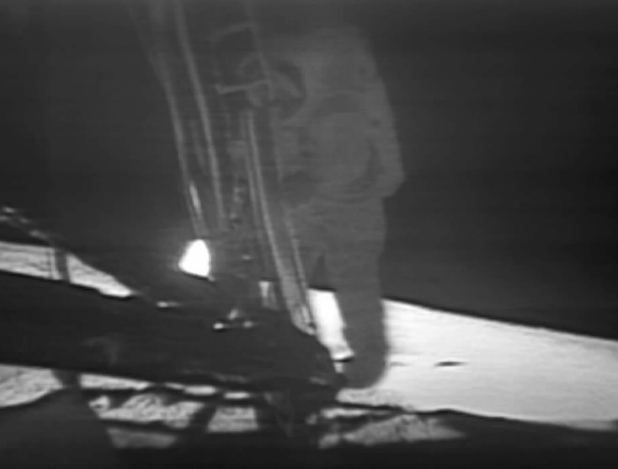 Neil Armstrong putting first step on moon. Photograph taken by a scanner camera