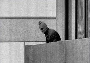 Munich massacre. A Black September terrorist in the Israeli team's quarters. Photograph by Kurt Strumpf. © 1972 The Associated Press.