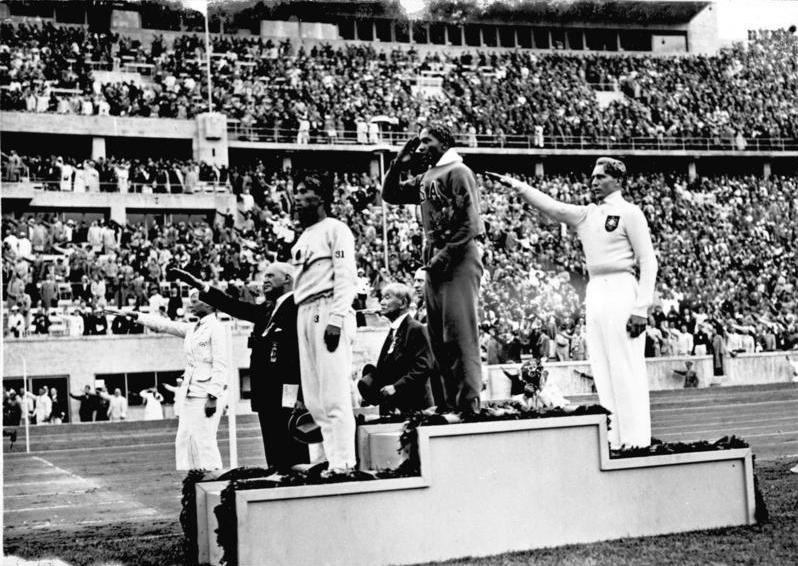 Jesse Owens on Gold Medal podium. Berlin Olympics (1936). Photograph by Hoffmann