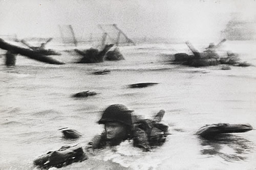 Allied Forces soldiers invading Omaha beach on 6 June 1944. Photograph by Robert Capa.