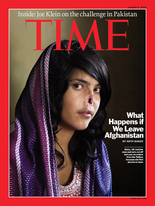 Disfigured face of an Afghan girl, Aisha, on the Time magazine's cover. Photograph by Jodi Bieber.