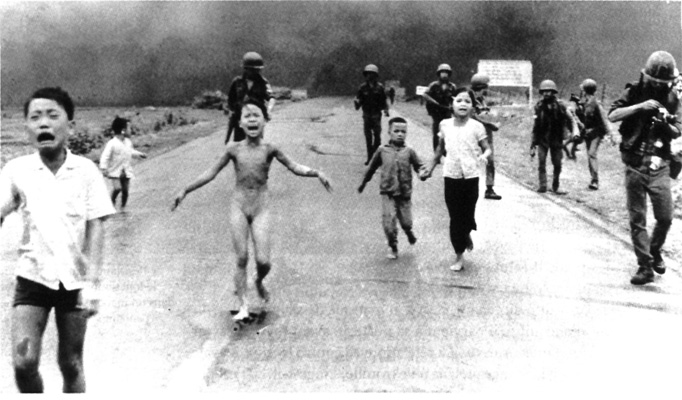 Phan Thi Kim Phuc (center) running after a napalm strike on her village in Vietnam. Photographer Nick Ut. (© Nick Ut/The Associated Press)