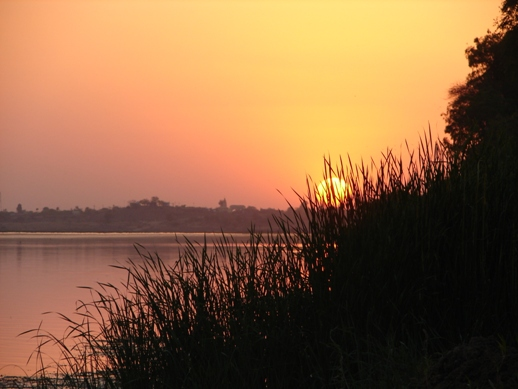 Sunset over Narmada river in Maheshwar. Photograph by Lalit Kumar.