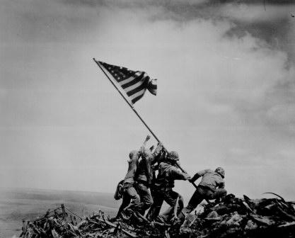 Raising of Flag on Iwo Jima. Photographer Joe Rosenthal (Associated Press).