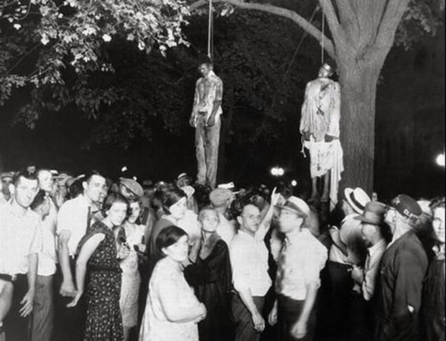 These two black men were lynched by a mob of 10,000 white people. Photographer: Lawrence Beitler.