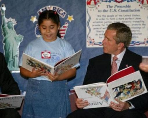 Fake photograph showing George W. Bush holding a book upside down.