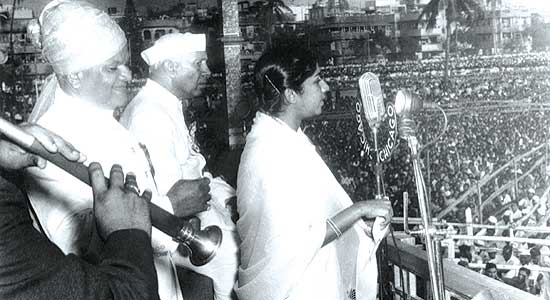 "Lata Mangeshkar singing ""Aye Mere Watan Ke Logon"" on 26 January 1963 in Delhi's Ramlila Maidan."