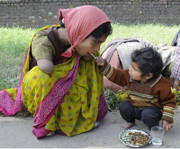 Little Vaishnavi offering food to her mother Sangeeta. Photograph by A.M. Faruqui. Courtesy: The Hindu newspaper; a major English daily in India.