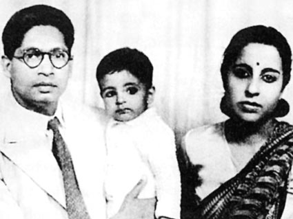 Young Amitabh Bachchan in the arms of Harivanshrai Bachchan.
